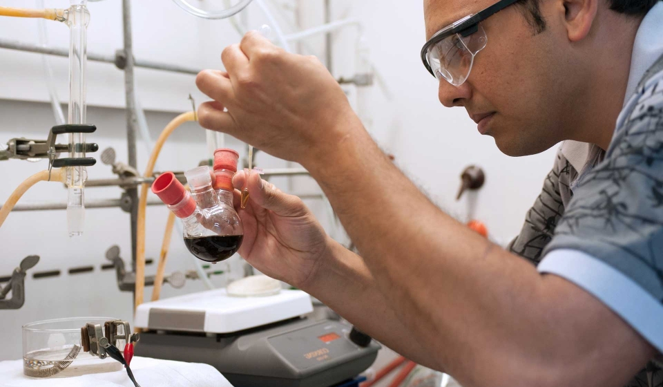 A Chemistry student working in a lab