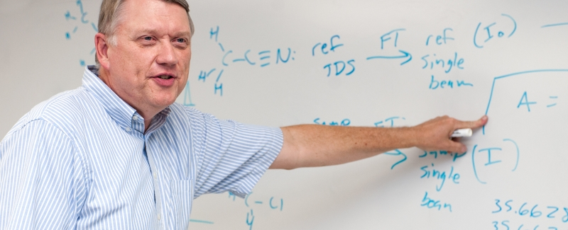 A Chemistry professor teaching a class.